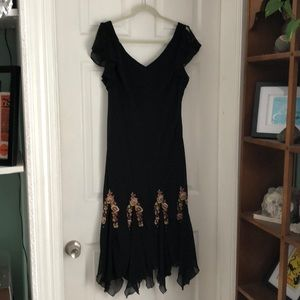Fluttery black dress with great details